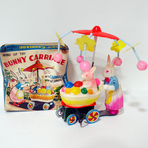BUNNY CARRIAGE WITH CARROUSEL WIND UP TOY